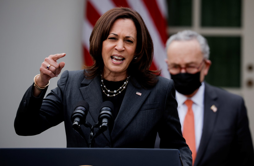 """US Vice President Kamala Harris speaks about the $1.9 trillion """"American Rescue Plan Act"""" as Senate Majority Leader Chuck Schumer (D-NY) listens during an event to celebrate the legislation in the Rose Garden at the White House in Washington, US, March 12, 2021.  (photo credit: REUTERS/TOM BRENNER)"""