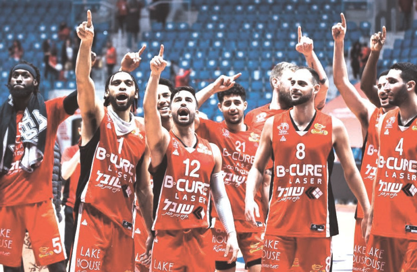 HAPOEL HAIFA players celebrate on the court after their surprise 100-87 road victory over Hapoel Jerusalem in Israel Winner League action in the capital. (photo credit: DOV HALICKMAN PHOTOGRAPHY)