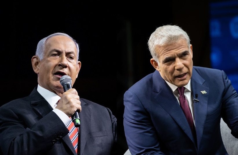 Prime Minister Benjamin Netanyahu and Yesh Atid leader Yair Lapid (photo credit: YONATAN SINDEL/FLASH90)