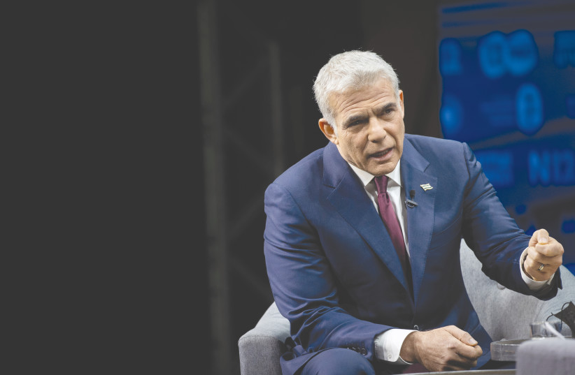 YESH ATID Party leader Yair Lapid – voting for him is voting for sanity. (photo credit: YONATAN SINDEL/FLASH90)