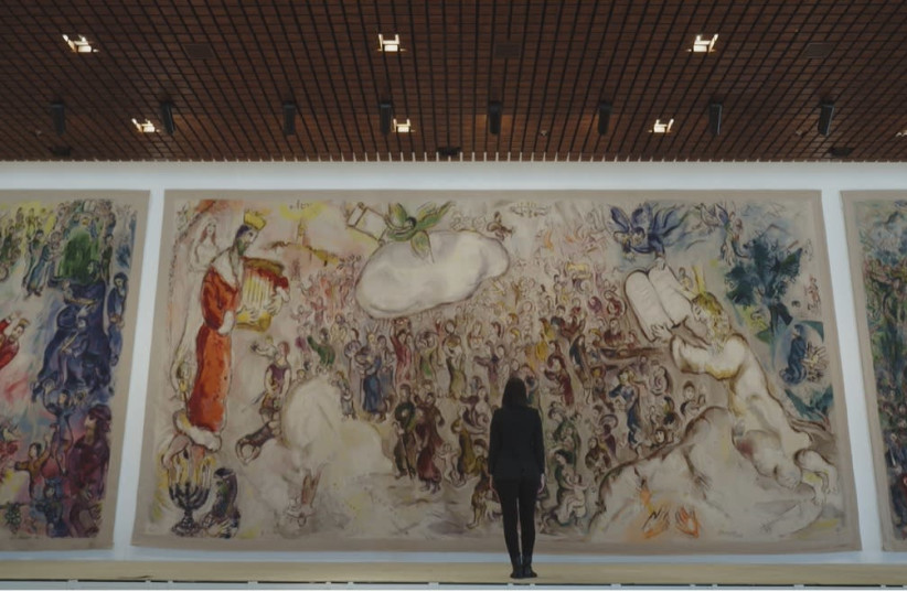 As part of Beit Avi Chai's online offerings, Israeli journalist Romy Neumark, center, narrates a series of short films on artistic works that bring Jewish holidays to light, including this painting by Marc Chagall at Israel's Knesset. (photo credit: BEIT AVI CHAI)