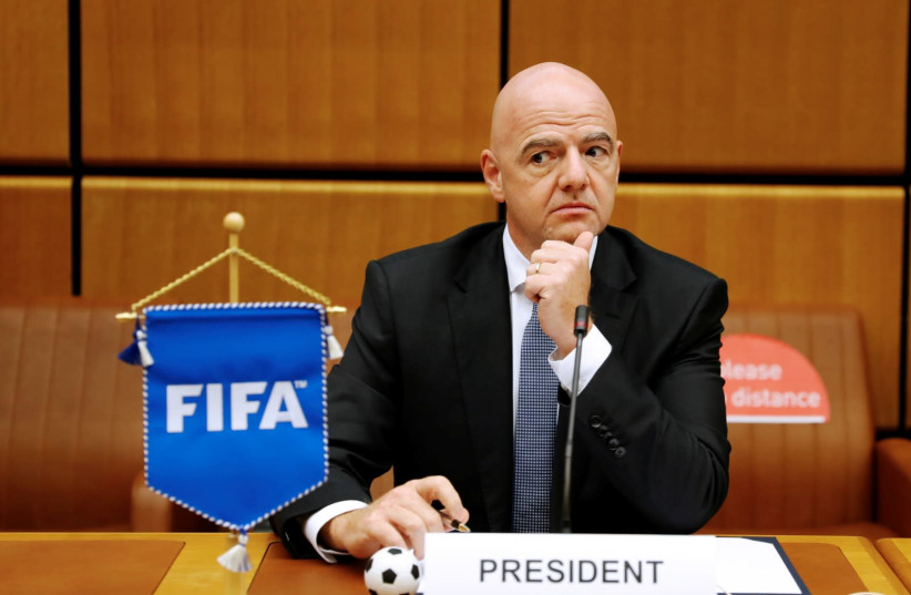FIFA President Gianni Infantino waits for the start of a signing ceremony at the United Nations Office on Drugs and Crime (UNODC) headquarters in Vienna, Austria September 14, 2020.  (photo credit: LEONHARD FOEGER / REUTERS)