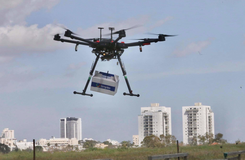 A drone delivery over Hadera  (photo credit: MARC ISRAEL SELLEM)