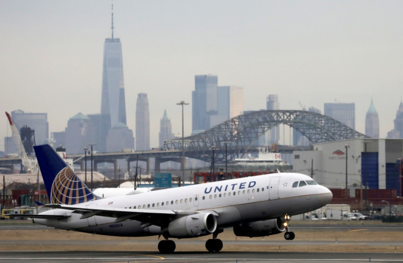 A United Airlines passenger jet takes off with New York City as a backdrop, at Newark Liberty International Airport. (photo credit: CHRIS HELGREN/REUTERS)