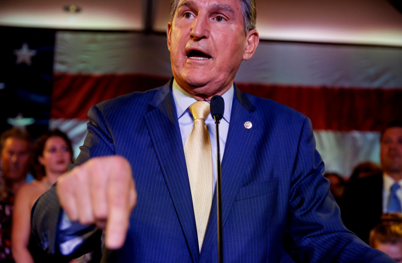 Senator Joe Manchin (D-WV) speaks after winning his 2018 midterm election in Charlestown, West Virginia, US, November 6, 2018. (photo credit: JOSHUA ROBERTS / REUTERS)