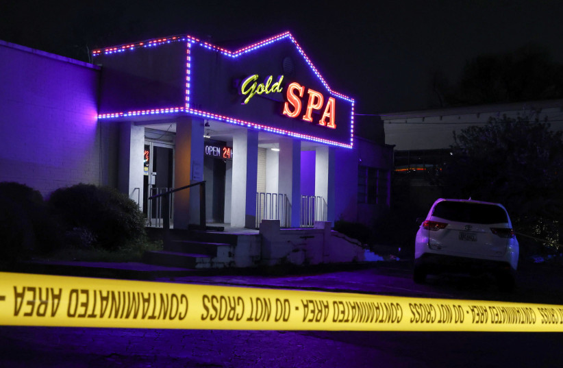Crime scene tape surrounds Gold Spa after deadly shootings at a massage parlor and two day spas in the Atlanta area, in Atlanta, Georgia, U.S. March 16, 2021. (photo credit: CHRIS ALUKA BERRY/ REUTERS)