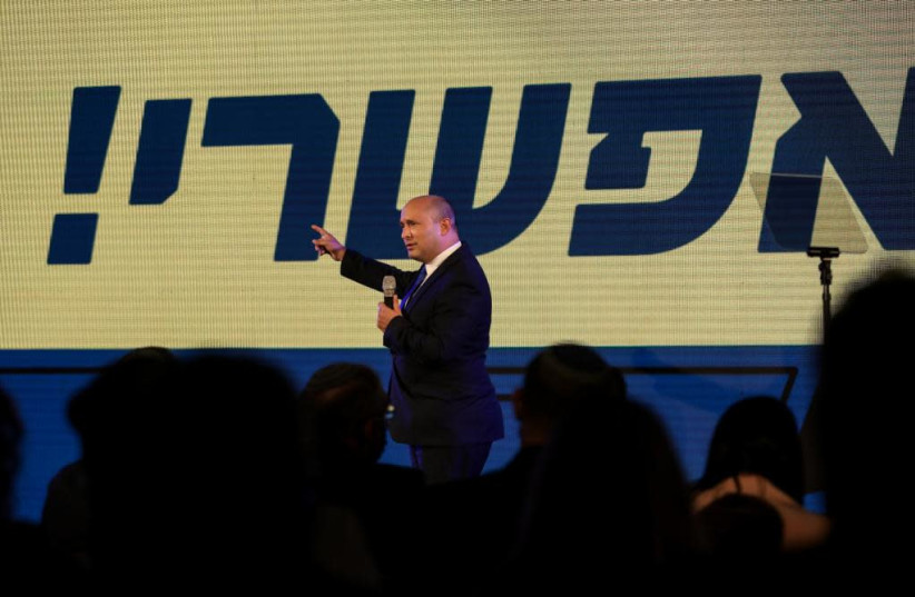 Yamina leader Naftali Bennett boasted at a campaign rally in Sderot on Wednesday night that it is still possible for him to become prime minister following Tuesday's election. (photo credit: ARIEL ZANDBERG)