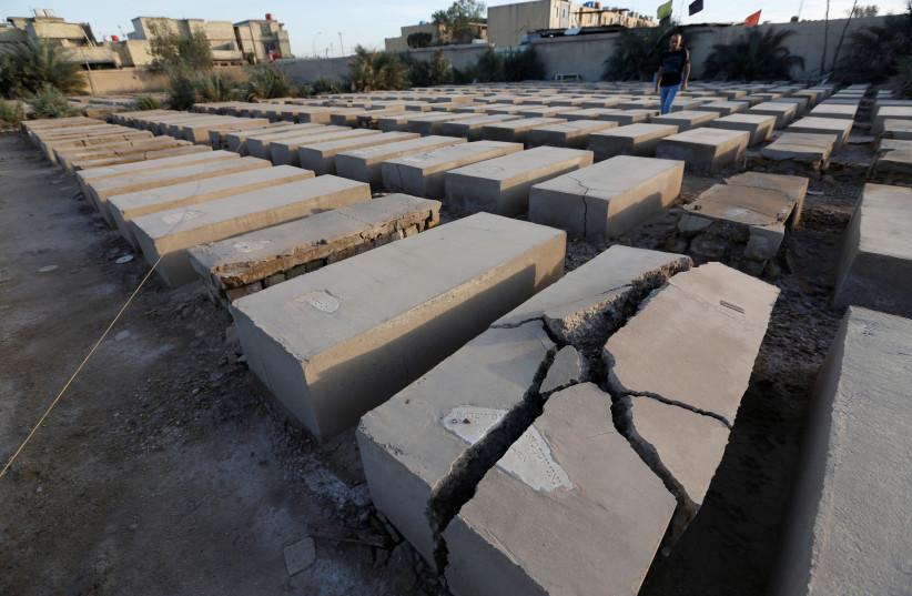 A Jewish cemetery is seen at the Sadr City district of Baghdad, Iraq (photo credit: WISSIM AL-OKILI/REUTERS)
