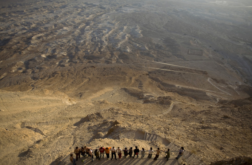 Tourists at Masada in 2008. The novel takes place during the Great Jewish Revolt against Rome, a war that ended at the battle of Masada. (photo credit: REUTERS)