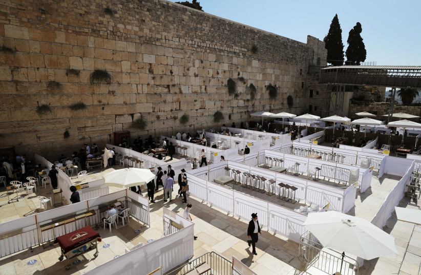The Western Wall last year. A radical Jewish poet in the 1930s equated Jewish clannishness to American racism, using the Western Wall as an indictment of Zionism. (photo credit: AMMAR AWAD/REUTERS)