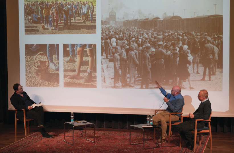 MATAN BEN CNAAN (center) points out similarities in his painting to a Holocaust photograph, as curator Amitai Mendelsohn (left) and David Grossman look on. (photo credit: OFRIT ROSENBERG, ISRAEL MUSEUM)
