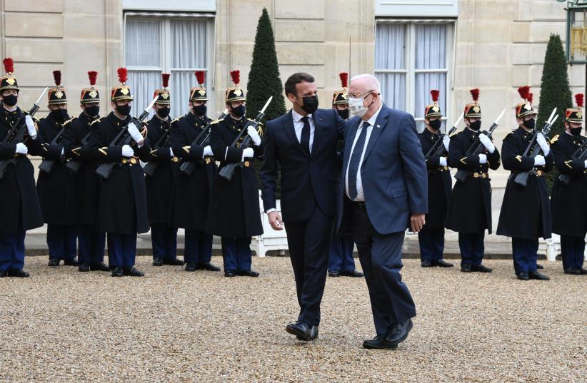 French President Emmanuel Macron and President Reuven Rivlin at the Palais de l'Elysee in Paris, France.  (photo credit: AMOS BEN-GERSHOM/GPO)