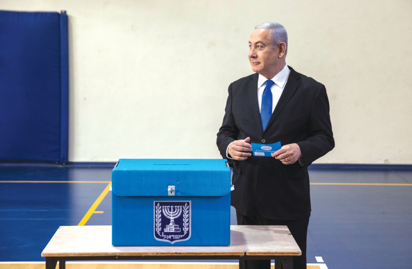 Prime Minister Benjamin Netanyahu votes  in the September 2019 election. (photo credit: HEIDI LEVINE)