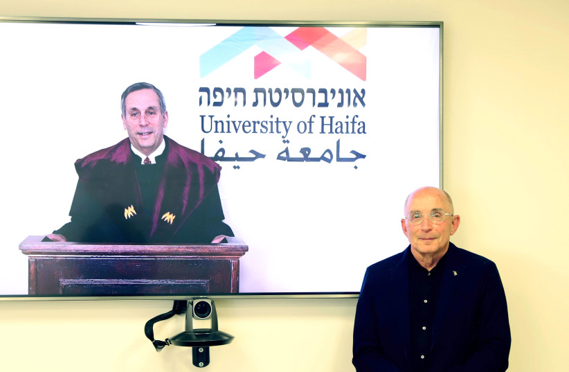 President Bacow receiving an honorary doctorate from University of Haifa (photo credit: UNIVERSITY OF HAIFA)
