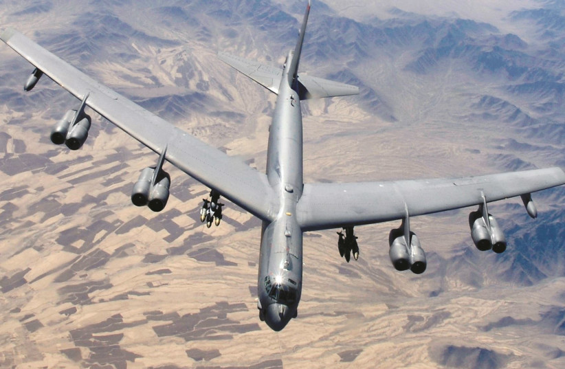 A B-52 STRATOFORTRESS prepares for refueling during a close-air-support mission. (photo credit: US AIR FORCE/SGT. LANCE CHEUNG/REUTERS)