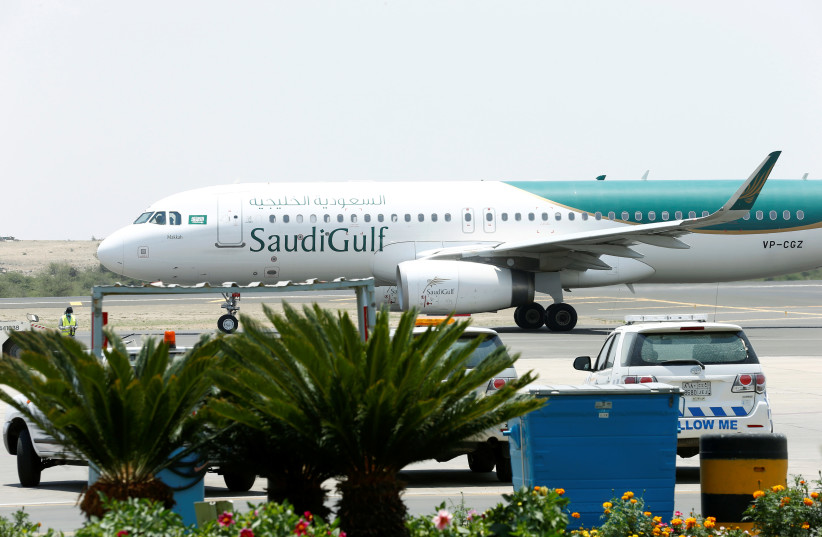 A Saudi Gulf Airlines Airbus A320-200 airplane is seen at Saudi Arabia's Abha airport, after it was attacked by Yemen's Houthi group in Abha, Saudi Arabia June 13, 2019 (photo credit: REUTERS)