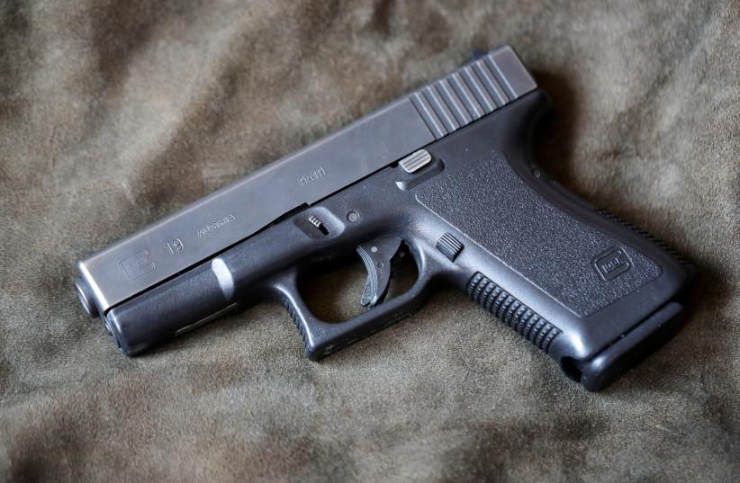 A Glock 19, 9 mm Para pistol is seen in Vienna, Austria, March 22, 2018. (photo credit: REUTERS/HEINZ-PETER BADER)