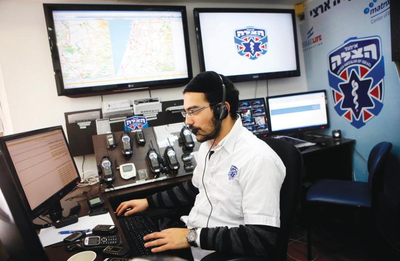 A DISPATCHER works in headquarters of United Hatzalah in Jerusalem.  (photo credit: MIRIAM ALSTER/FLASH90)
