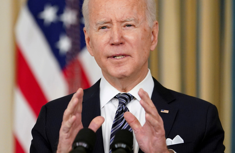 US President Joe Biden speaks in the State Dining Room at the White House in Washington, US, March 15, 2021 (photo credit: REUTERS/KEVIN LAMARQUE/FILE PHOTO)