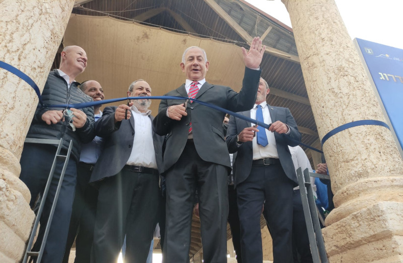 Prime Minister Benjamin Netanyahu cutting a ribbon at the site of the ancient Sussiya synagogue in the South Hebron Hills last week. (photo credit: DUDI AVITAN)