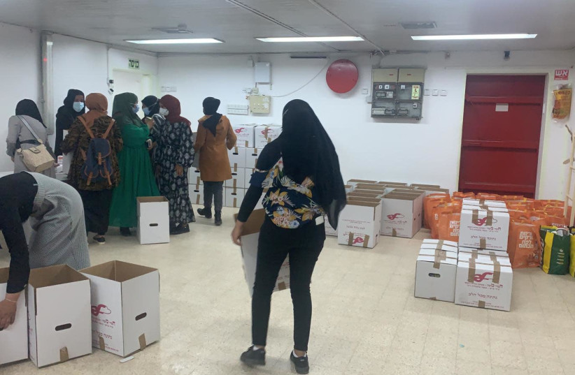 Bedouin activists pack food-aid boxes meant for Jewish families ahead of Passover  (photo credit: AGUDA SHERUT)