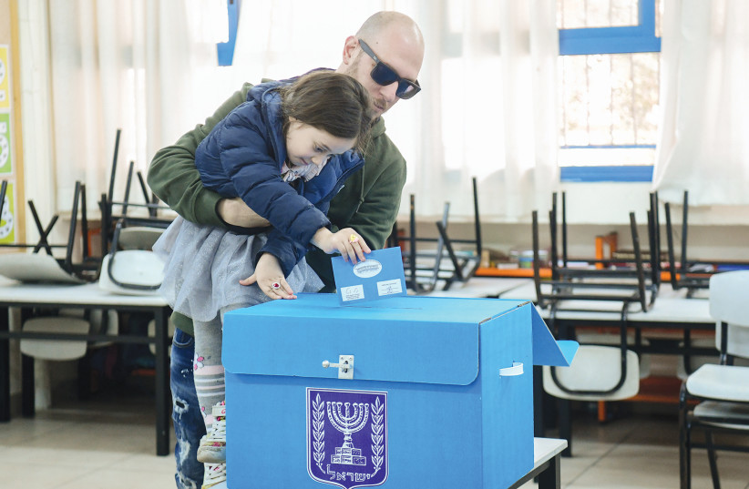 People cast their ballot at a voting station in Tel Aviv during the Knesset election on March 2, 2020. (photo credit: FLASH90)