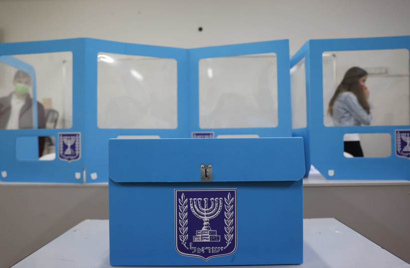 Israel Elections: A polling station in Jerusalem, as Israelis vote in their general elections, on March 23, 2021. (photo credit: YONATAN SINDEL/FLASH 90)