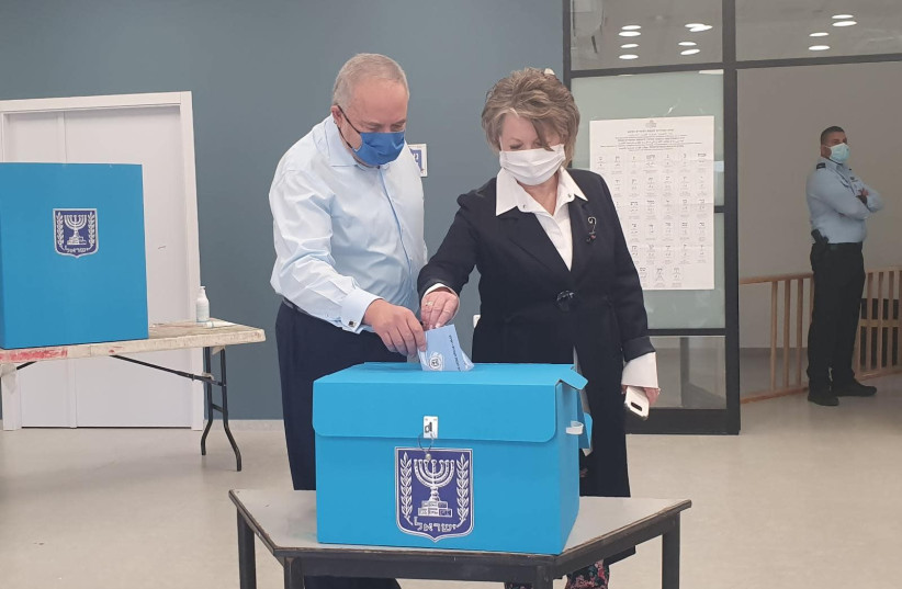 Head of Yisrael Beytenu Party, Avigdor Liberman, together with his wife, Ella Liberman, voted in a polling station near their house in Nokdim. (photo credit: MIRI SHIMONOVITZ)
