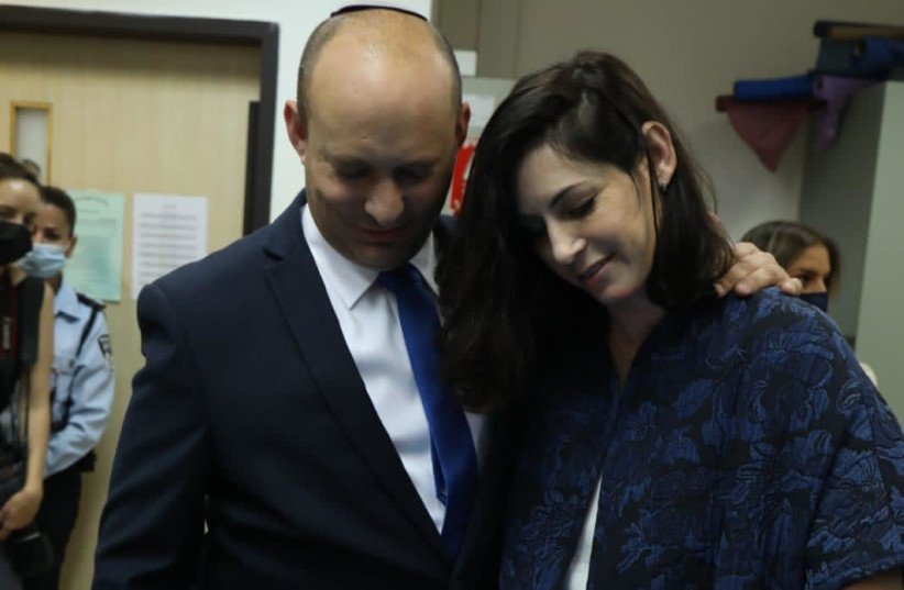 Right-wing chairman and candidate for prime minister, Naftali Bennett, now votes in Raanana accompanied by his wife Gilat (photo credit: ARIEL ZANDBERG)
