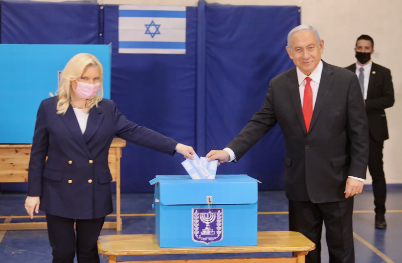 Prime Minister Benjamin Netanyahu and his wife Sara vote on March 23, 2021. (photo credit: MARC ISRAEL SELLEM/THE JERUSALEM POST)