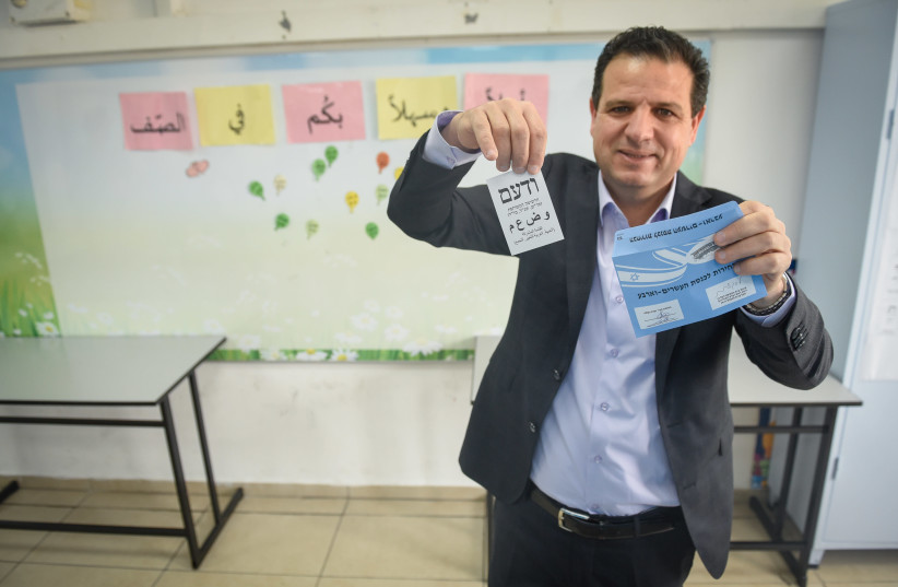 Joint List Party leader Ayman Odeh casts his ballot at a voting station in Hafia, during the Knesset Elections, on March 23, 2021. (photo credit: RONI OFER/FLASH90)