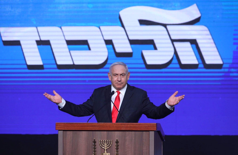 Prime Minister Benjamin Netanyahu speaks to his supporters after the exit polls were announced for the election of the 24th Knesset, March 24, 2021. (photo credit: MARC ISRAEL SELLEM)