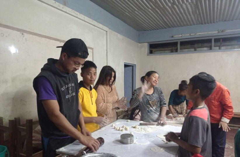 India's Bnei Menashe community prepares matzah for Passover. (photo credit: SHAVEI ISRAEL)