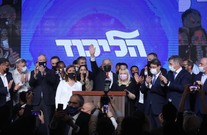 Prime Minister Benjamin Netanyahu celebrates with the Likud after Israel's elections, March 23, 2021. (photo credit: MARC ISRAEL SELLEM/THE JERUSALEM POST)