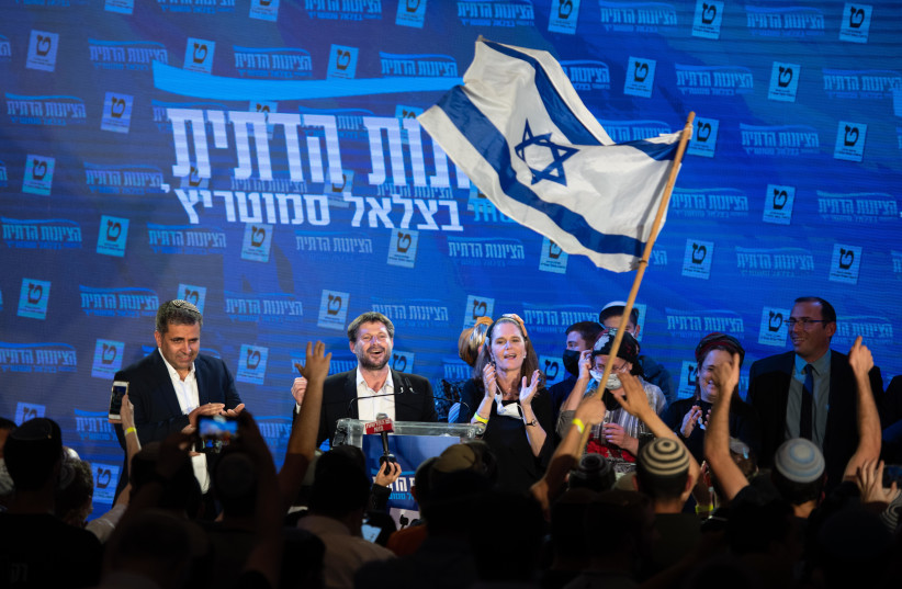 Bezalel Smotrich and party members are seen with supporters at the Religious Zionist Party headquarters in Modi'in, on elections night, March 23, 2021. (photo credit: SRAYA DIAMANT/FLASH90)