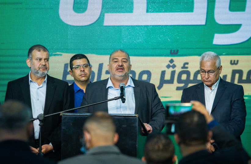 Ra'am Party leader Mansour Abbas and party members at the party headquarters in Tamra, on election night, March 23, 2021. (photo credit: FLASH90)