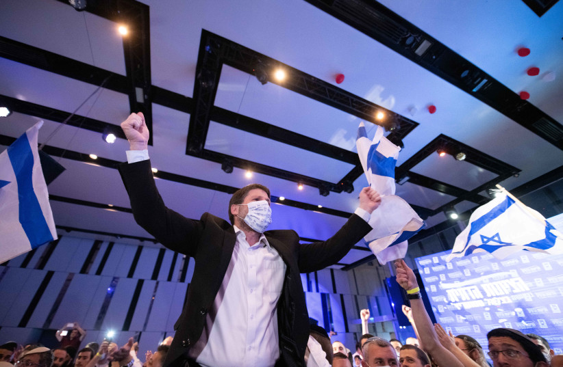 Bezalel Smotrich is seen with supporters and party members at the Religious Zionist Party headquarters in Modi'in, on elections night, March 23, 2021. (photo credit: SRAYA DIAMANT/FLASH90)