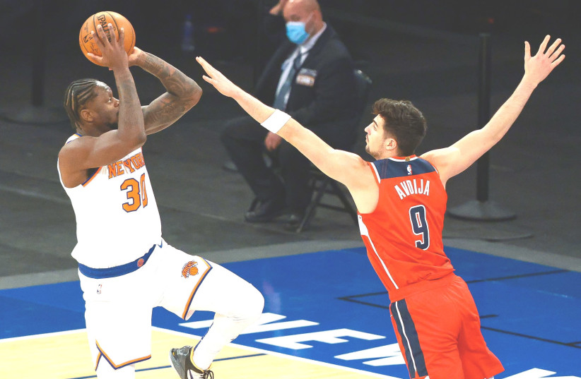 WASHINGTON WIZARDS Israeli rookie Deni Avdija (right) defends New York Knicks forward Julius Randle, who scored a game-high 37 points for the host Knicks in a 131-113 victory over the Wizards on Tuesday night at Madison Square Garden. (photo credit: VINCENT CARCHIETTA/USA TODAY SPORTS)