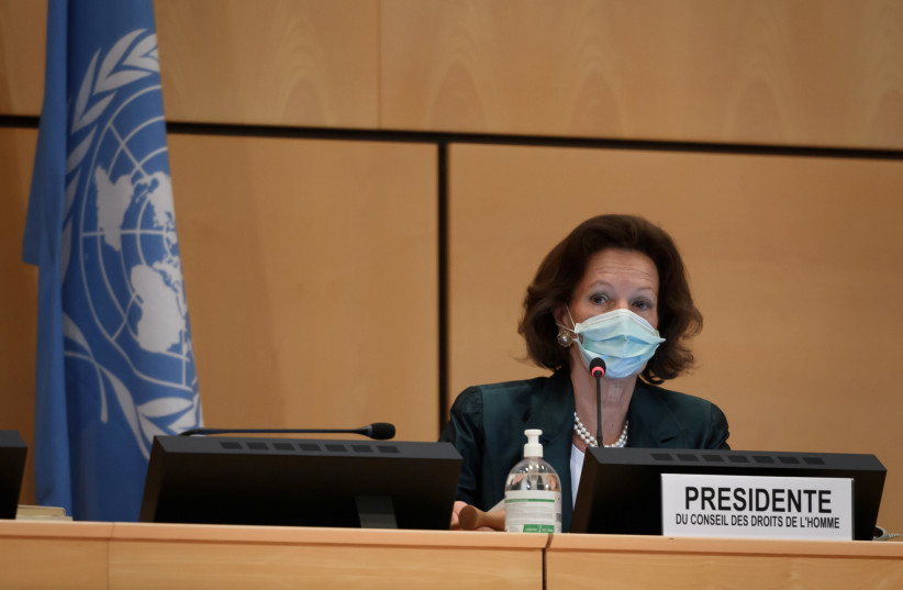 """President of the Human Rights Council Elisabeth Tichy-Fisslberger, wearing a protective face mask, attends the resuming of a United Nations Human Rights Council session before an urgent debate on allegations of """"systemic racism, police brutality and violence against peaceful protests"""" in the United  (photo credit: FABRICE COFFRINI/POOL VIA REUTERS)"""