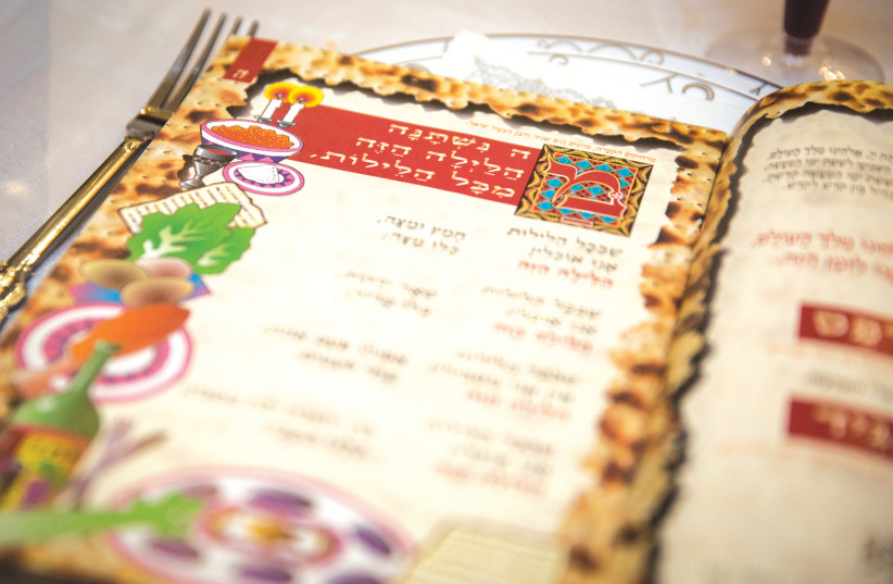 THE HAGGADAH is read during a Passover Seder. (photo credit: HADAS PARUSH/FLASH90)