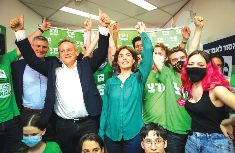 MERETZ PARTY Chairman Nitzan Horowitz and party members celebrate at party headquarters in Tel Aviv on election night on Tuesday. (photo credit: FLASH90)