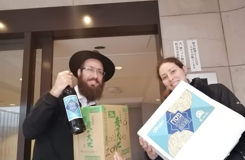 Chabad emissaries in the Far East distributing Passover packages of matzah and wine (photo credit: CHABAD)