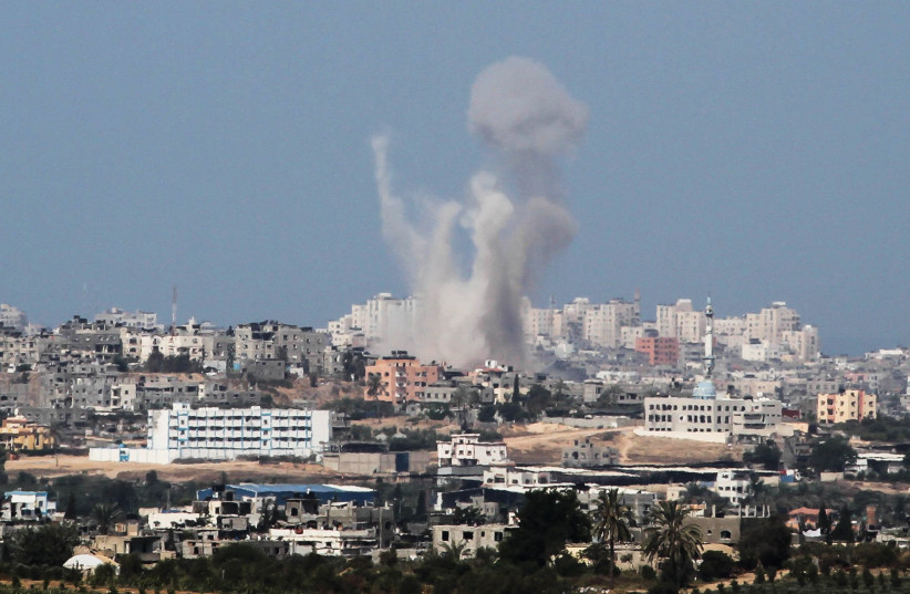 SMOKE RISES from the Gaza Strip following an IDF military strike, August 2014.  (photo credit: ALBERT SADIKOV/FLASH90)