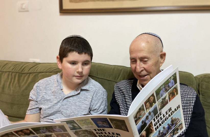 ALL IN the family: The writer reviews the  Haggadah with a grandchild. (photo credit: COURTESY STUART GELLER)