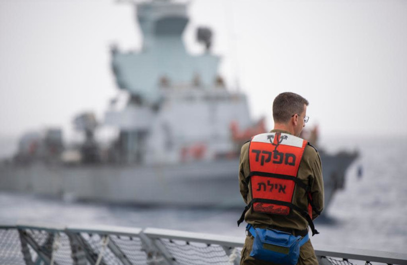 A sailor on the OC INS Eilat takes part in the first naval drill held since COVID-19 broke out.  (photo credit: IDF SPOKESPERSON'S UNIT)