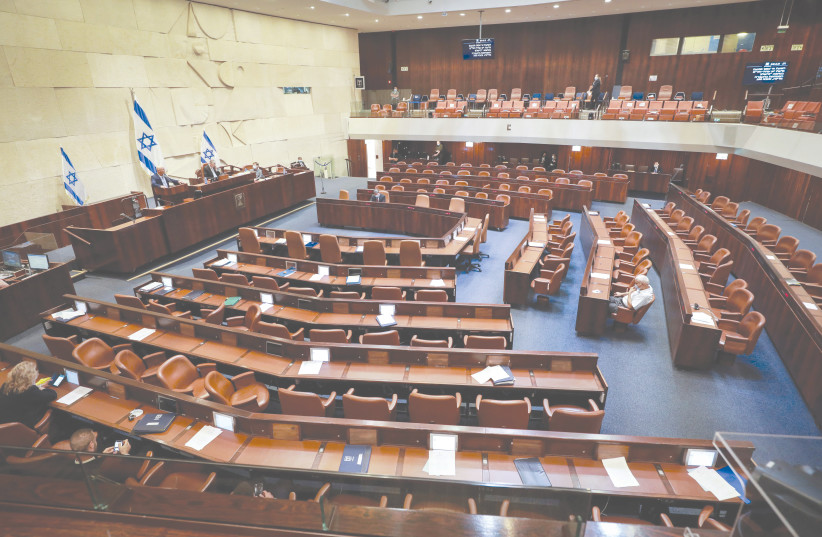 A PLENARY SESSION at the Knesset in Jerusalem awaits the arrival of more parliamentarians in August 2020 (photo credit: OREN BEN HAKOON/FLASH90)