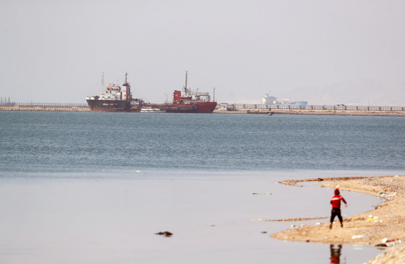 Ships are seen at the entrance of the Suez Canal, Egypt March 26, 2021. (photo credit: MOHAMED ABD EL GHANY/REUTERS)
