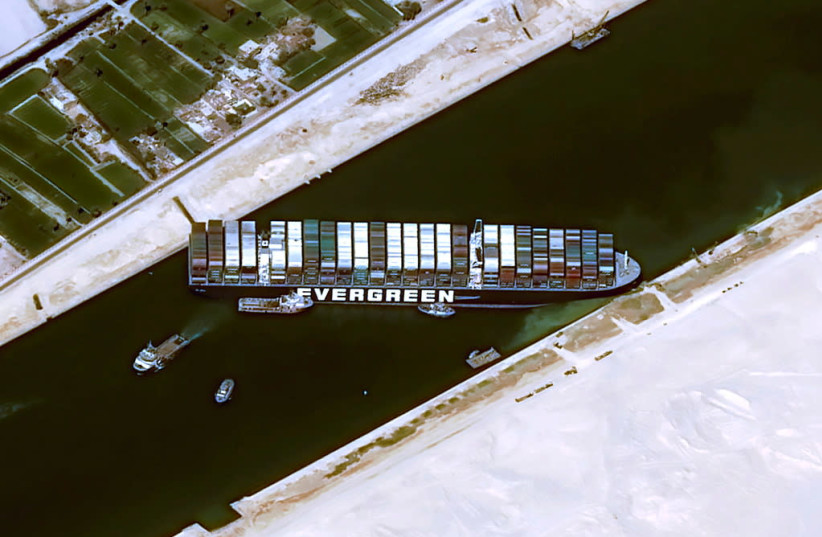 A satellite image shows stranded container ship Ever Given ran around in Suez Canal, Egypt March 25, 2021. (photo credit: CNES/AIRBUS DS VIA REUTERS)