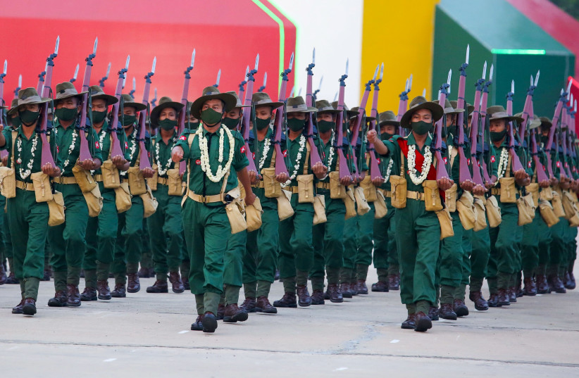 Military personnel participate in a parade on Armed Forces Day in Naypyitaw, Myanmar, March 27, 2021.  (photo credit: REUTERS/STRINGER)