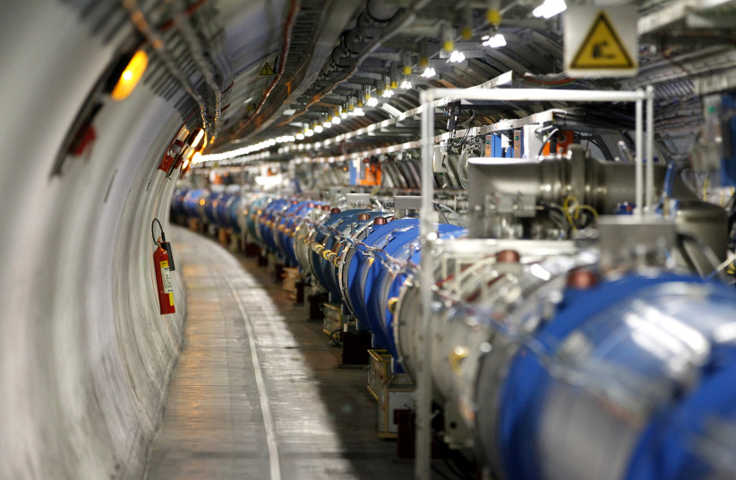 A general view of the Large Hadron Collider (LHC) experiment is seen during a media visit at the Organization for Nuclear Research (CERN) in the French village of Saint-Genis-Pouilly near Geneva in Switzerland, July 23, 2014 (photo credit: REUTERS/PIERRE ALBOUY)
